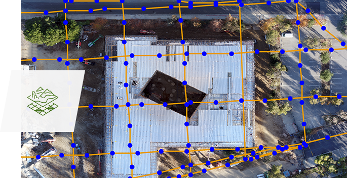 Aerial image of a building and parking lot with an added artificial grid layer