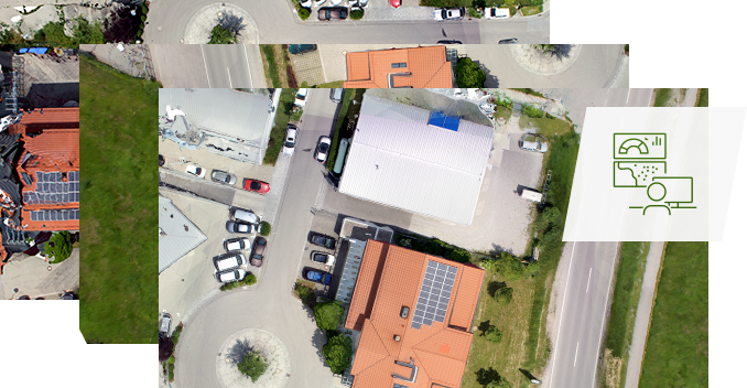 Three similar overlapping aerial images of the same business area, implying that they are being consolidated.