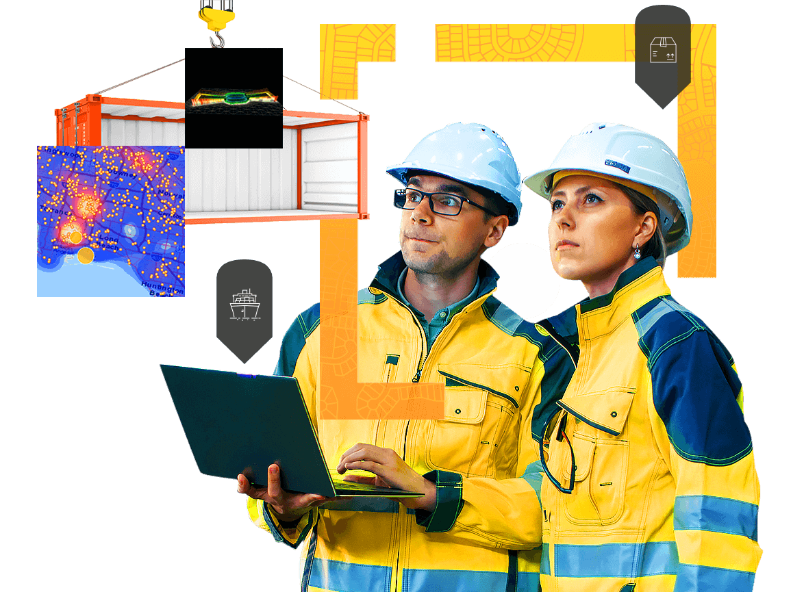 Man and woman in hardhats view logistics information on a laptop