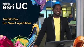 Image of a man in Esri offices next to 2020 Esri UC graphic