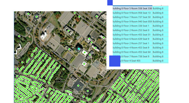 Aerial image of an office complex with green data points and building data