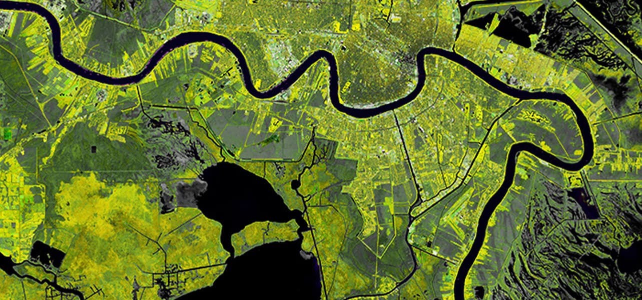 Satellite image of a city with a river running through it.