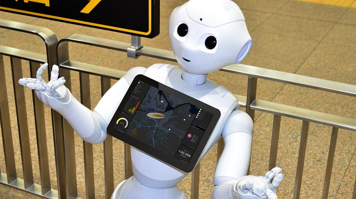 Robot med surfplatta som visar dashboard med kartvisualisering